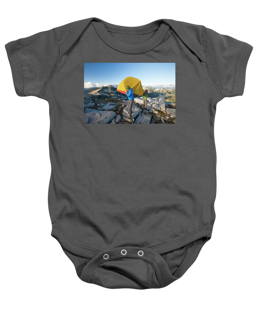 British Columbia Baby Onesie featuring the photograph A Couple Of Backpackers Carry by Christopher Kimmel