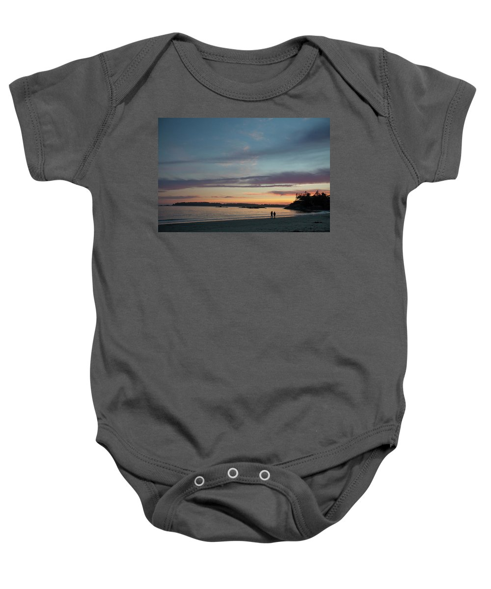 Heterosexual Couple Baby Onesie featuring the photograph A Couple Walk Along The Shore by Christopher Kimmel