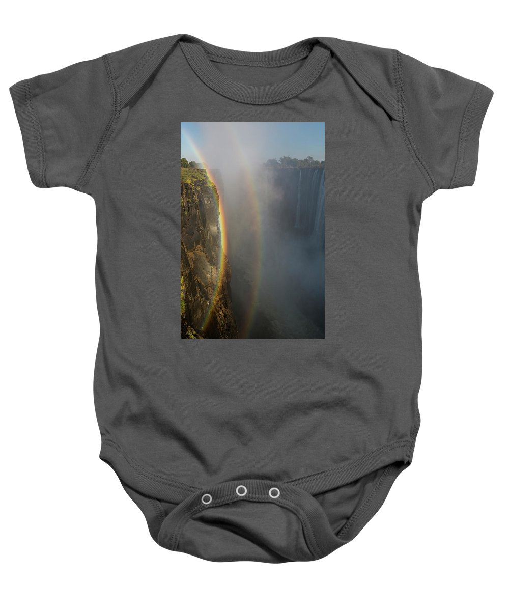 Mosi-oa-tunya Waterfall Baby Onesie featuring the photograph A Double Rainbow At Victoria Falls by Alexandra Simone