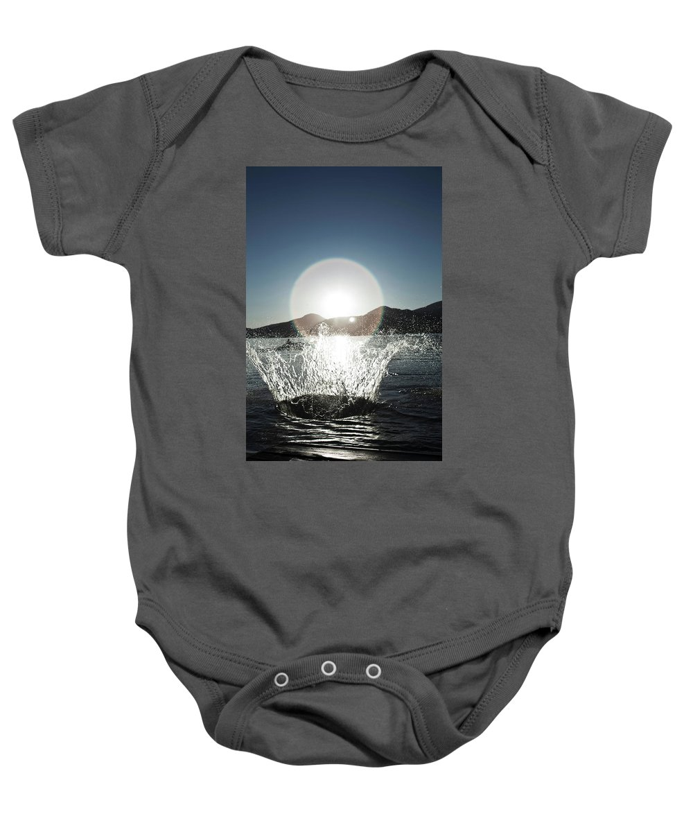 Action Baby Onesie featuring the photograph A Happy Young Women Canon Balls by Patrick Orton