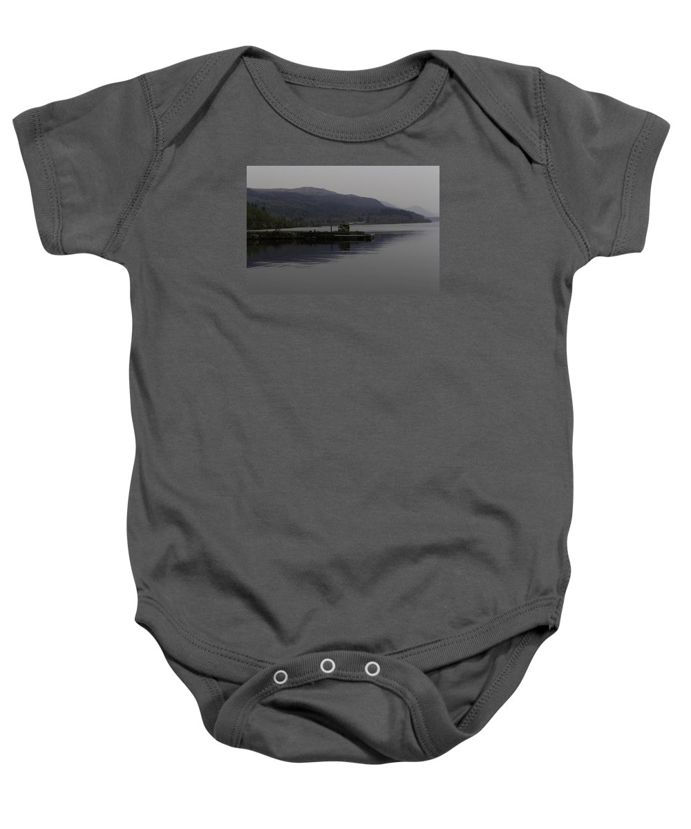 Great Britain Baby Onesie featuring the photograph A Jetty Pushing Out Into The Waters Of Loch Ness In Scotland by Ashish Agarwal
