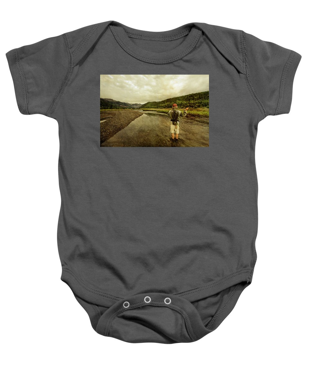 25-29 Years Baby Onesie featuring the photograph A Man Flyfishing On A River by Whit Richardson