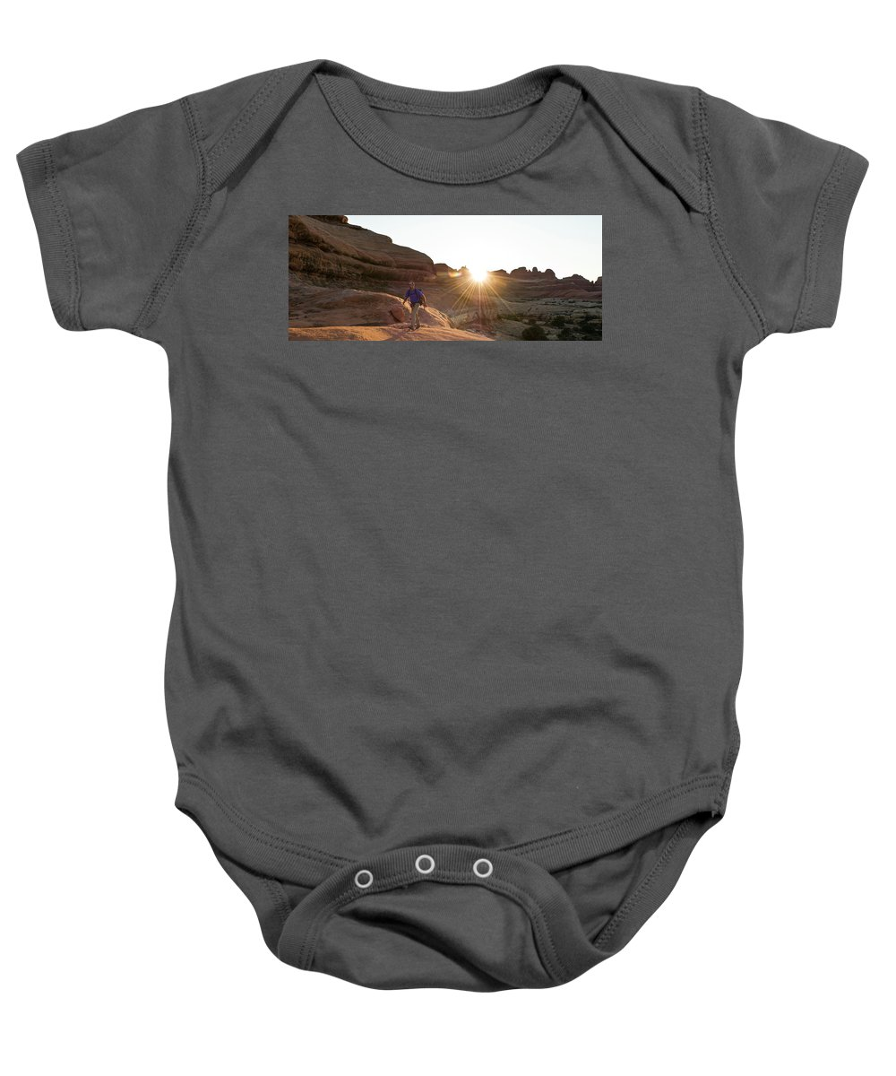 45-49 Years Baby Onesie featuring the photograph A Man Hiking In The Needles District by Kennan Harvey