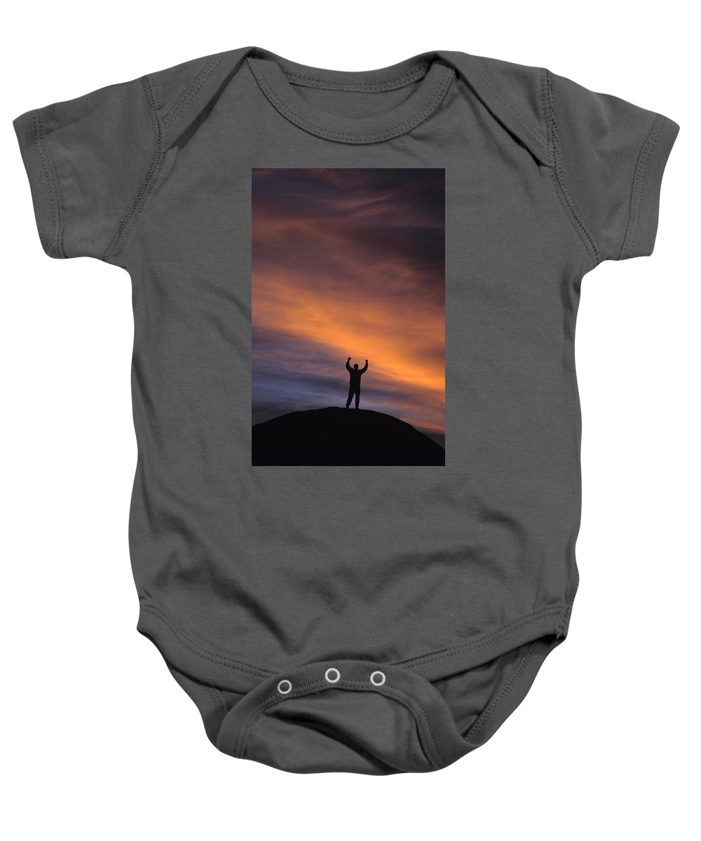 Accomplishment Baby Onesie featuring the photograph A Man In Lone Pine, California by Corey Rich