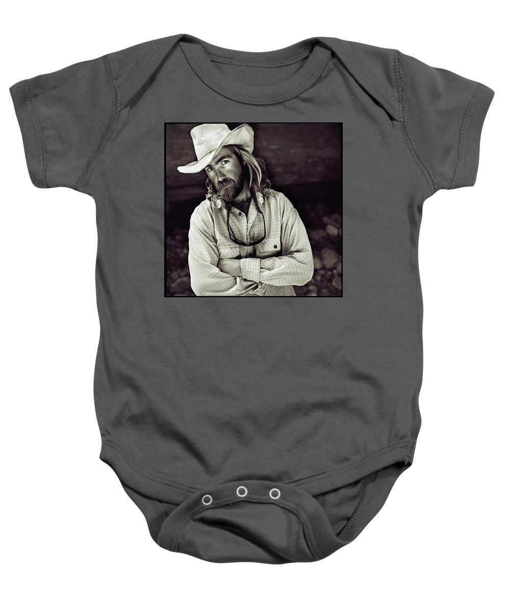 Arizona Baby Onesie featuring the photograph A River Guide Crosses His Arms In Front by Kyle George