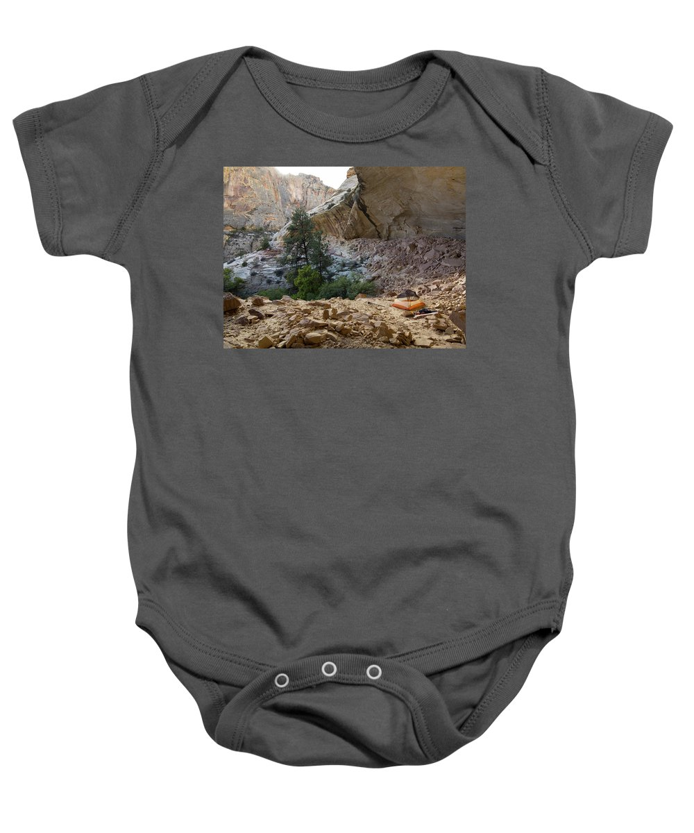 Adventure Baby Onesie featuring the photograph A Tent Pitched In A Large Alcove by Whit Richardson