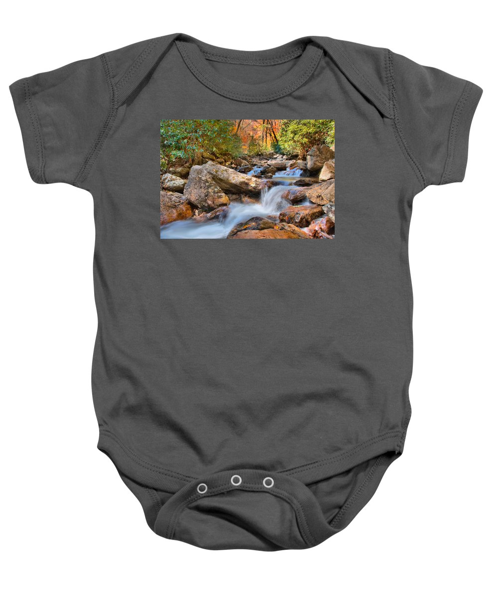 Appalacia Baby Onesie featuring the photograph A Touch Of Autumn At Skinny Dip Falls by Lynn Bauer