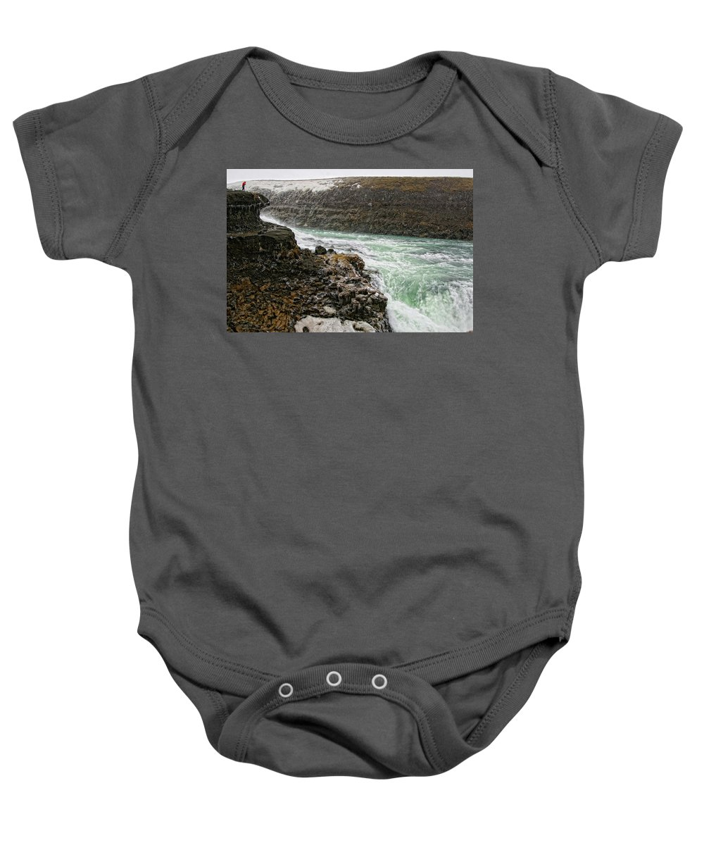 Gullfoss Waterfall Baby Onesie featuring the photograph A Tourist Takes A Photo At Gullfoss by Marc Pagani