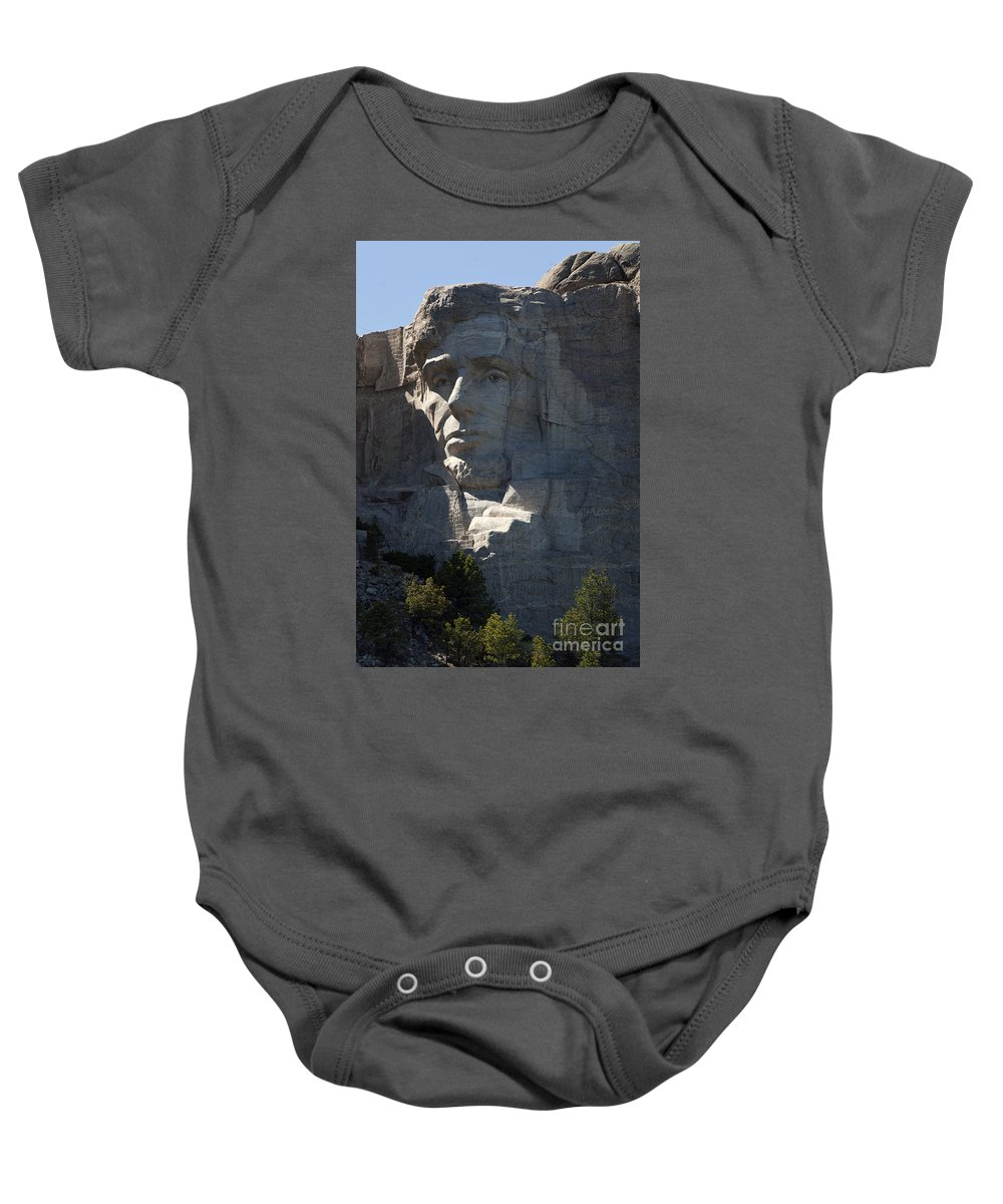 Mount Rushmore Baby Onesie featuring the photograph Abraham Lincoln Mount Rushmore National Monument by Jason O Watson