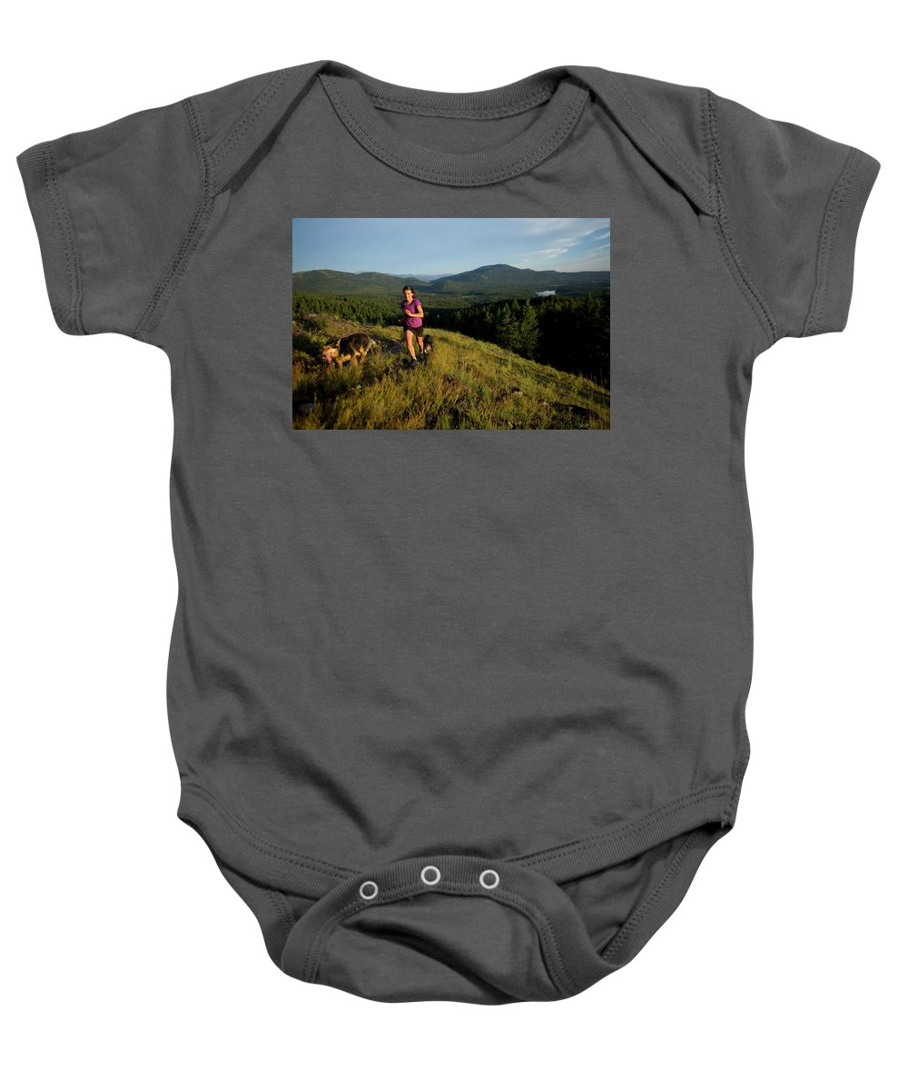 35-39 Years Baby Onesie featuring the photograph Adult Woman Trail Running by Woods Wheatcroft