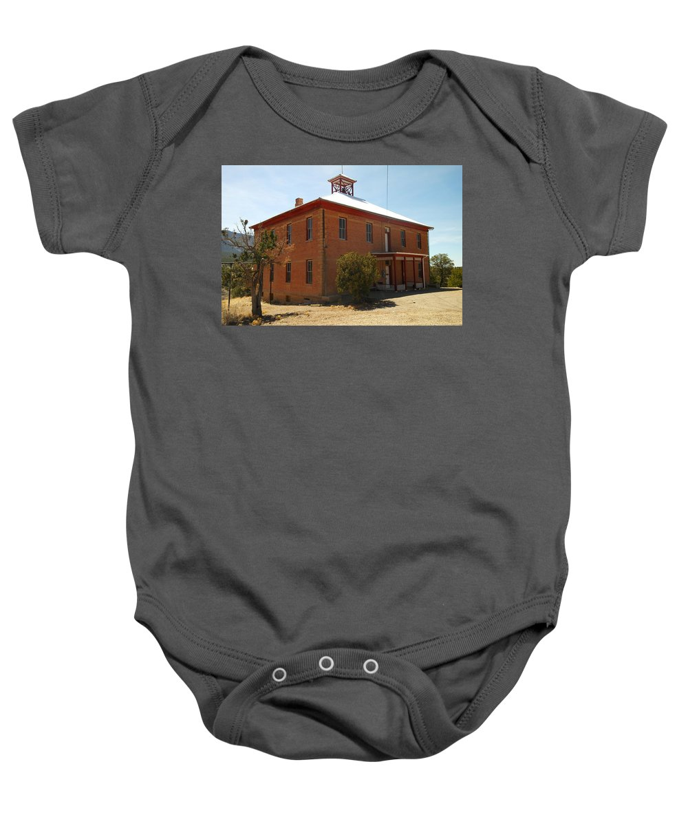 Old Baby Onesie featuring the photograph An Old School In White Oaks New Mexico by Jeff Swan