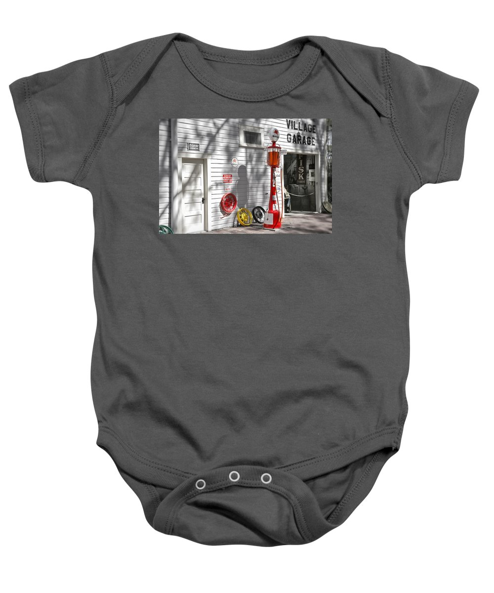 Garage Baby Onesie featuring the photograph An Old Village Gas Station by Mal Bray
