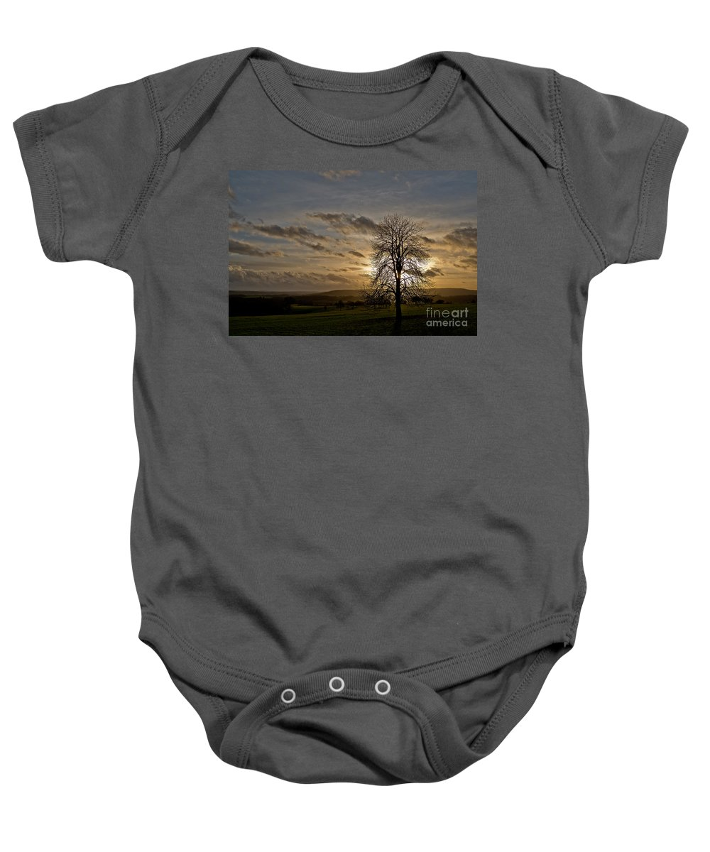Tree Baby Onesie featuring the photograph As Clouds Pass By by Brothers Beerens