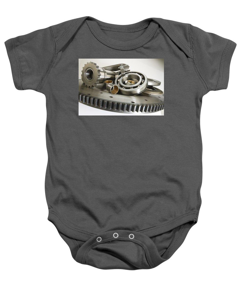 Automotive Baby Onesie featuring the photograph Automotive Clutch Parts by Garry McMichael