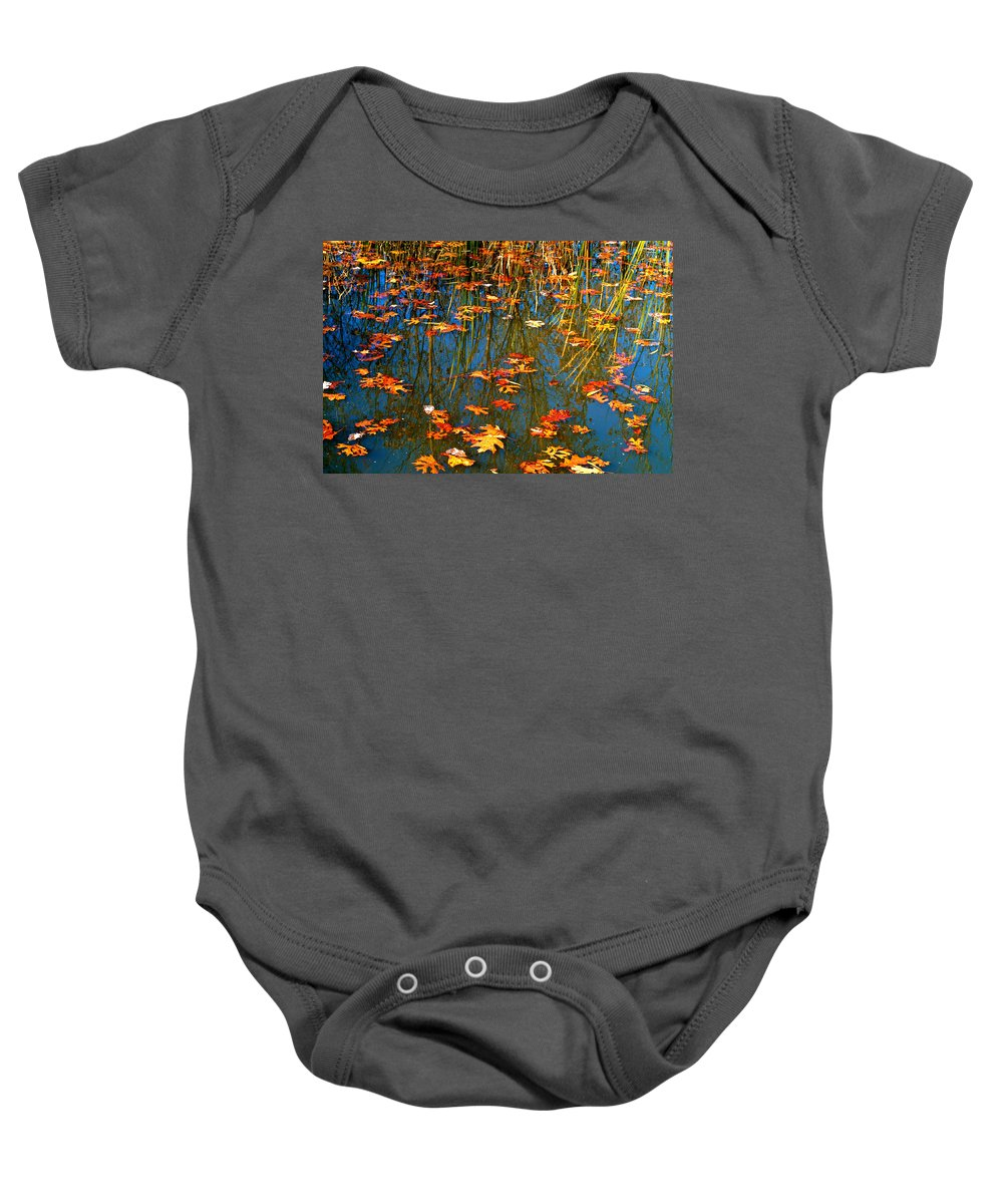 Autumn Baby Onesie featuring the photograph Autumn Floating by Peggy Franz