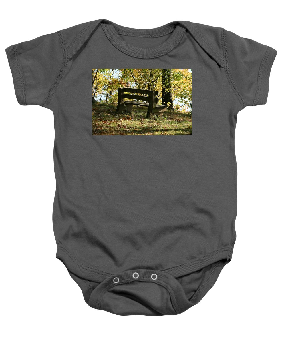 Bench Baby Onesie featuring the photograph Autumn Pleasures by Neal Eslinger