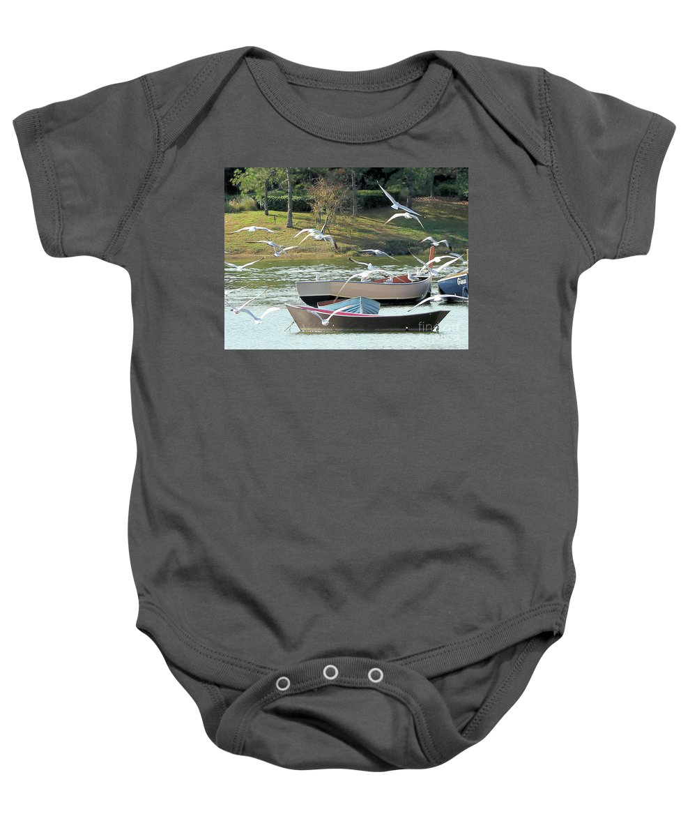 Lake Baby Onesie featuring the photograph Birds In Flight At The Lake by Christy Gendalia