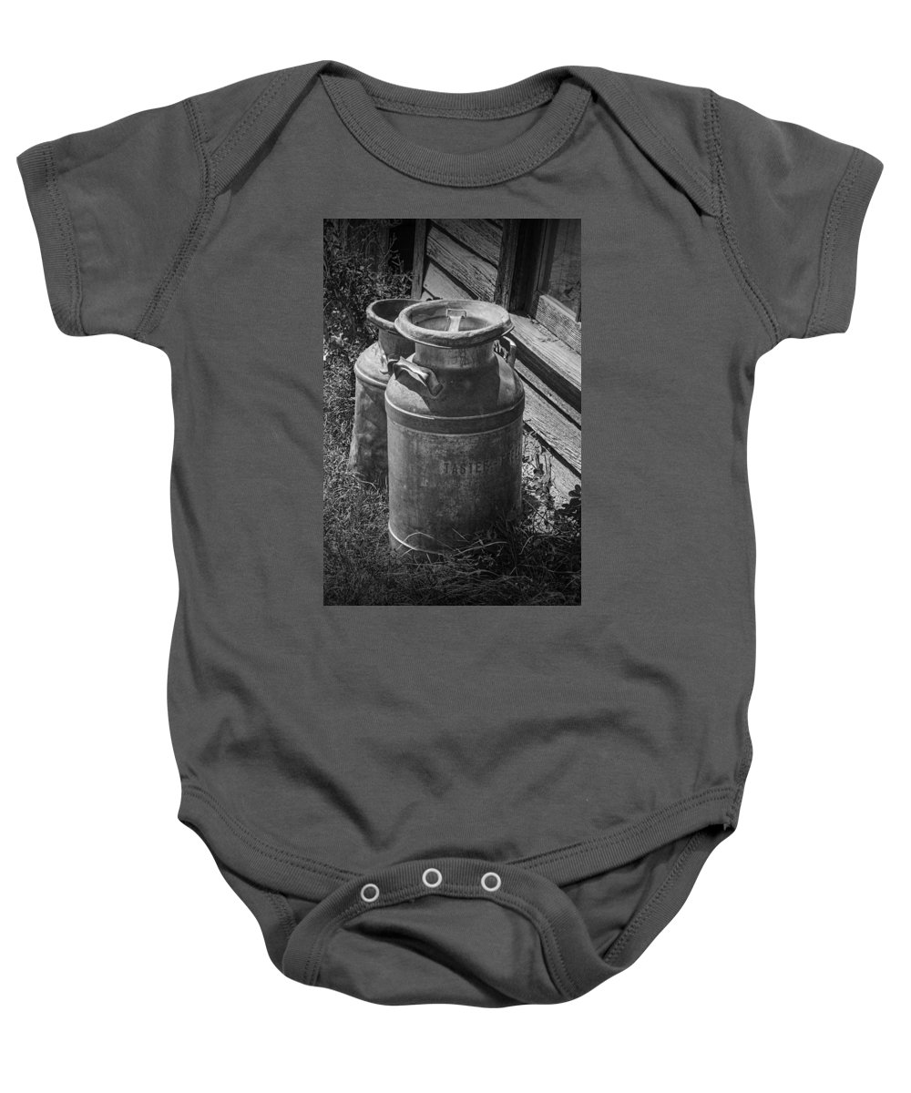 Creamery Can Baby Onesie featuring the photograph Black And White Old Prairie Homestead Vintage Creamery Cans Near The Badlands by Randall Nyhof