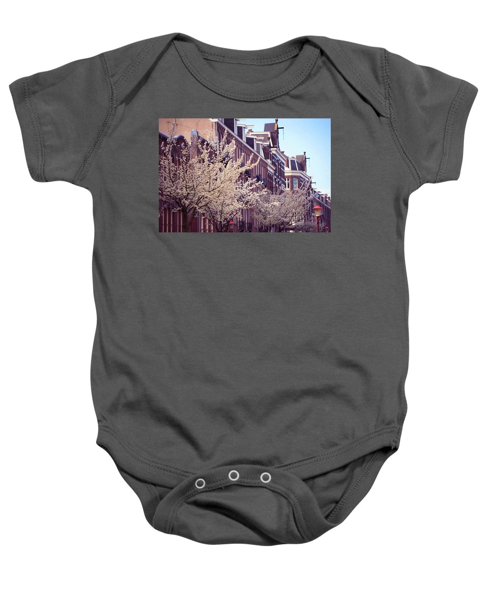 Spring Baby Onesie featuring the photograph Blooming Decoration Of The Streets. Pink Spring In Amsterdam by Jenny Rainbow