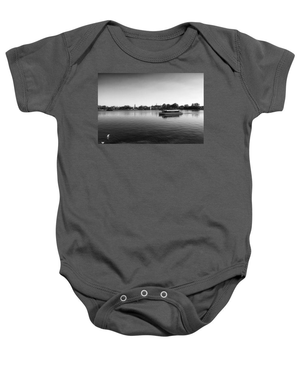 Black And White Baby Onesie featuring the photograph Boat Ride World Showcase Lagoon In Black And White Walt Disney World by Thomas Woolworth