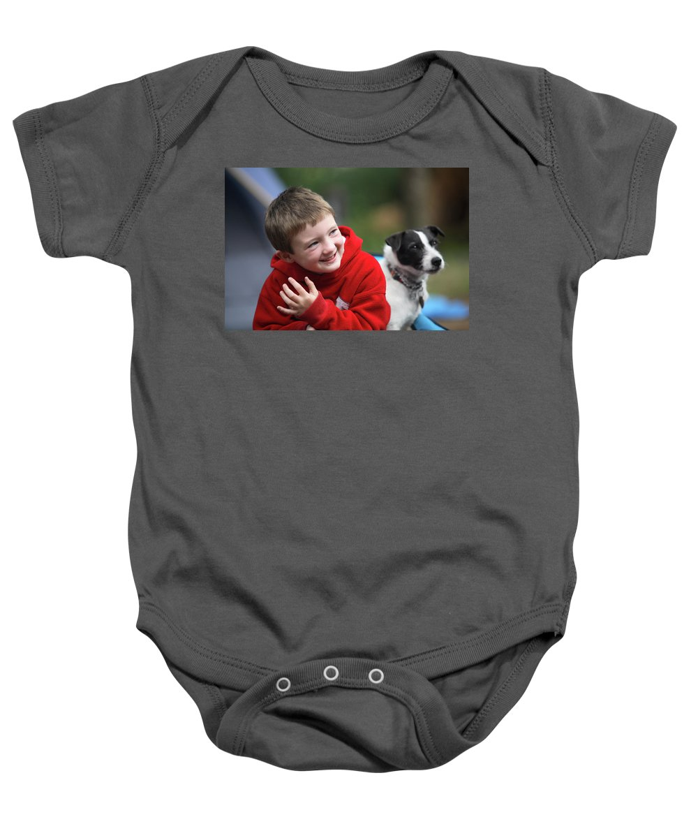 Boy Baby Onesie featuring the photograph Boy, Age 6, Smiling With Jack Russell by Chris Butler