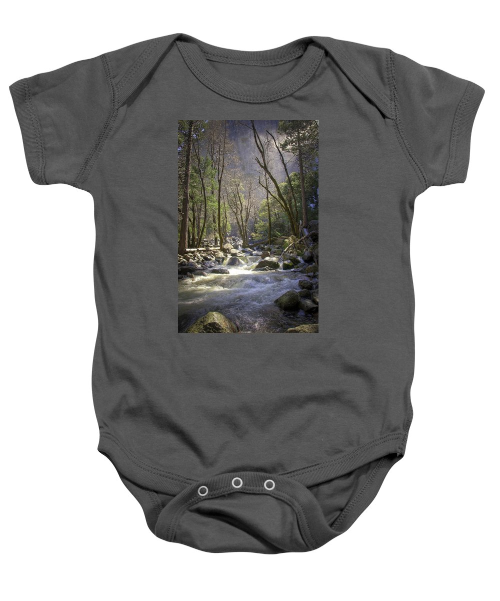 With It's Glorious Mist In The Background Baby Onesie featuring the photograph Bridalveil Falls Feeds A Marvelous Stream by Jon Zich