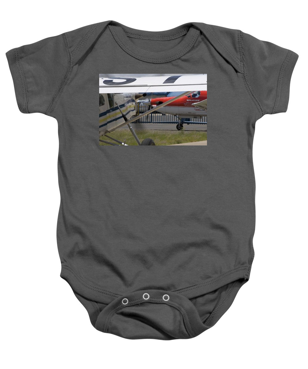 Pilatus Pc 12 Baby Onesie featuring the photograph Brother And Sister by Paul Job