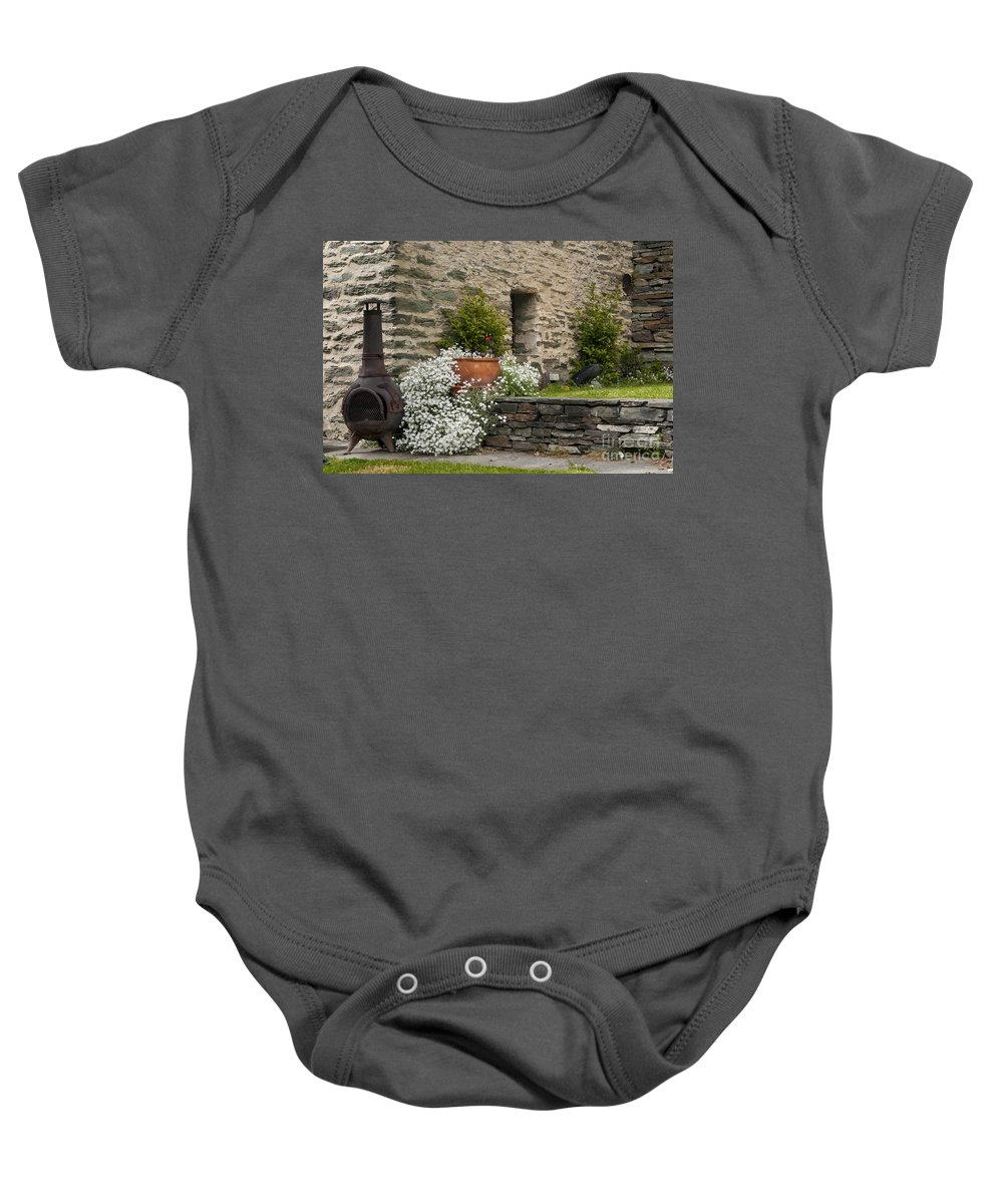 Arrow Town New Zealand Buckingham Street Foliage City Cities Cityscape Cityscapes Stone Architecture Flower Flowers Iron Wood Burning Stove Stoves Baby Onesie featuring the photograph Buckingham Street In Arrowtown by Bob Phillips