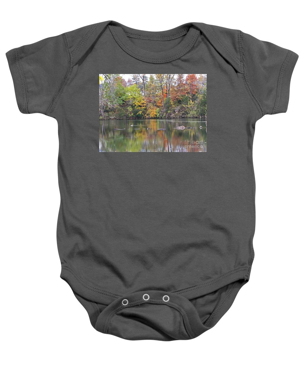 Autumn Baby Onesie featuring the photograph Canadian Goose Swimming Through The Autumn Reflections On The Pond by Minding My Visions by Adri and Ray
