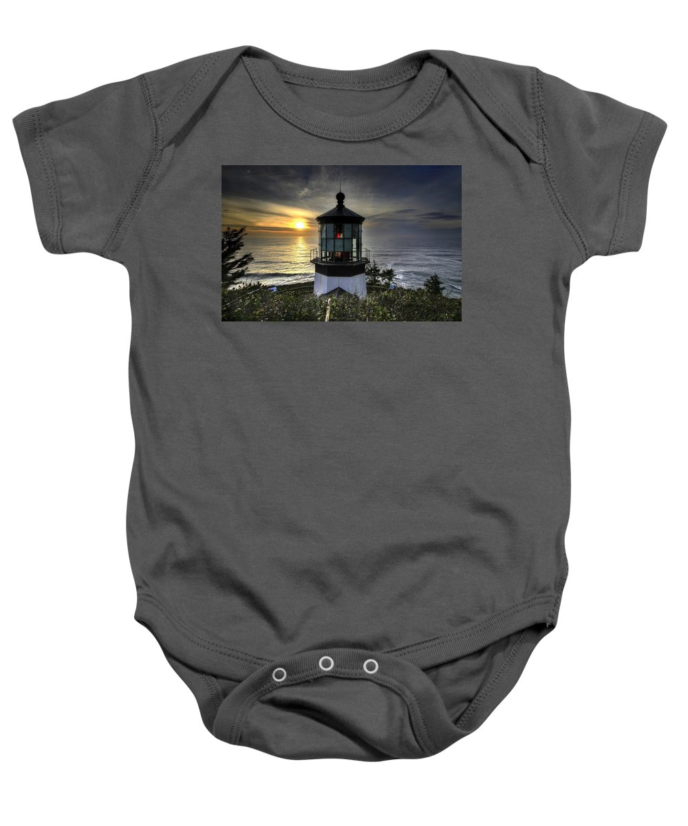 Cape Meares Baby Onesie featuring the photograph Cape Meares Lighthouse At Sunset by David Gn