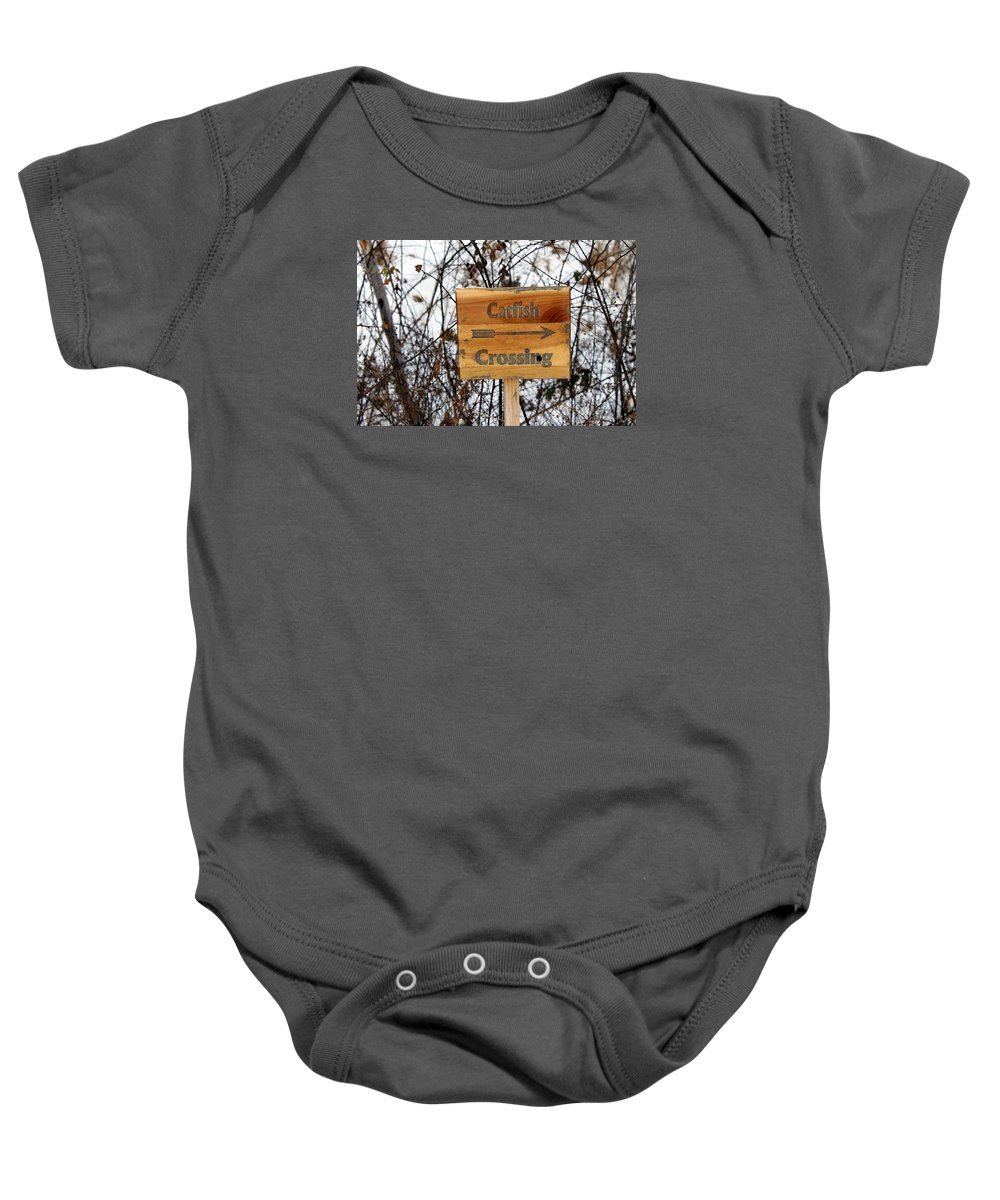 Signs Baby Onesie featuring the photograph Catfish Crossing by Wendy Gertz