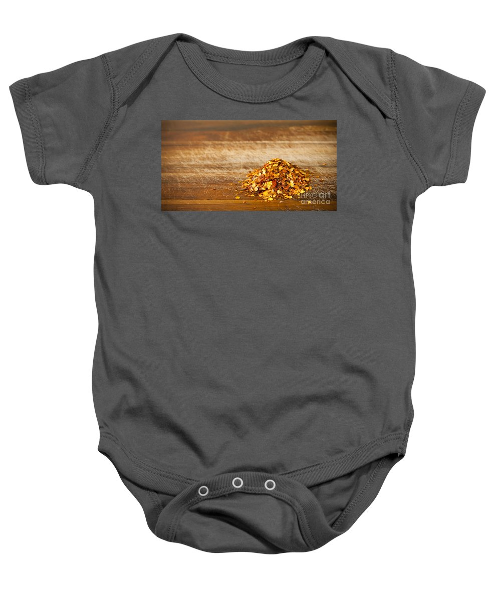 Background Baby Onesie featuring the photograph Chilli Seeds by Tim Hester