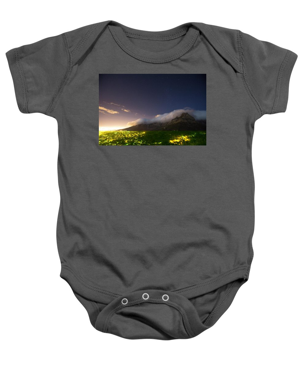 Illuminated Baby Onesie featuring the photograph Clouds Loom Over Table Mountain In Cape by Matt Andrew