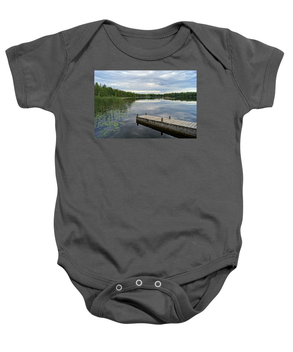 Dock Baby Onesie featuring the photograph Cloudy Colored Water by Bill Pevlor