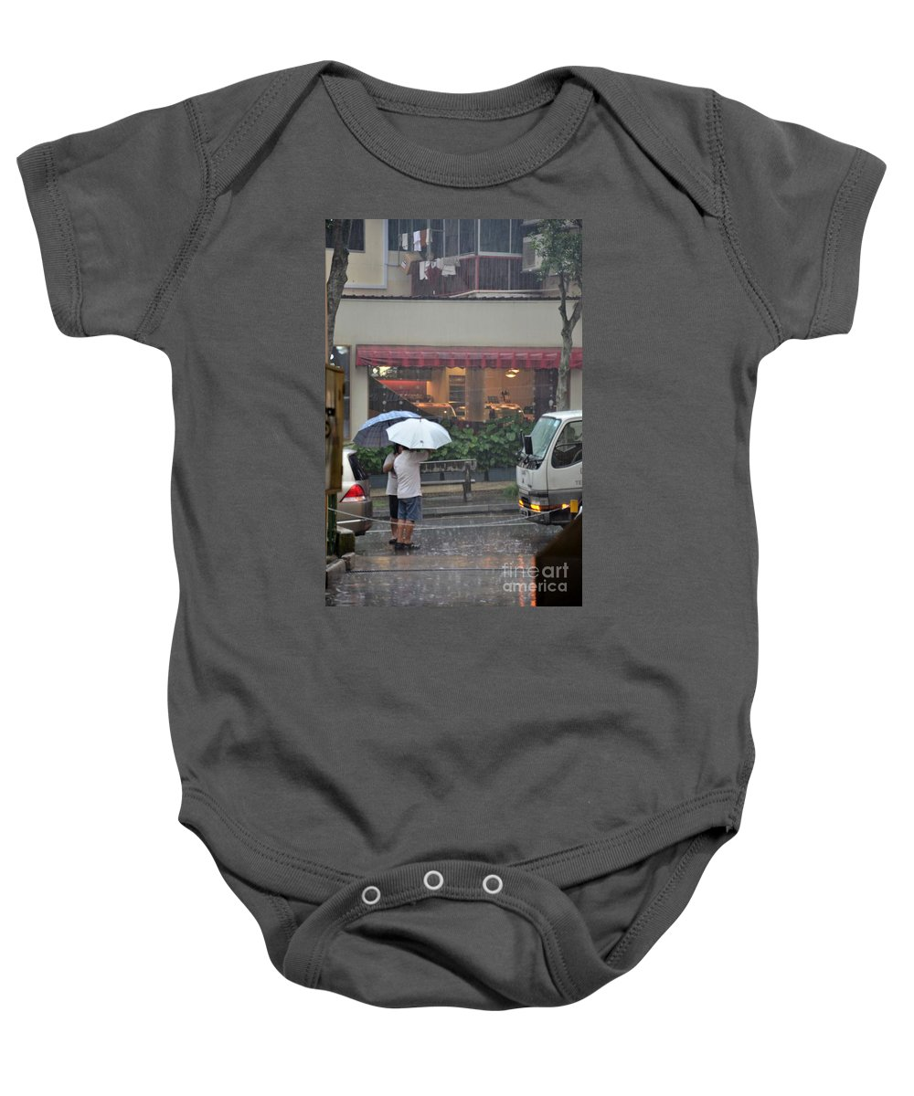 Singapore Baby Onesie featuring the photograph Conversation In The Rain by Imran Ahmed