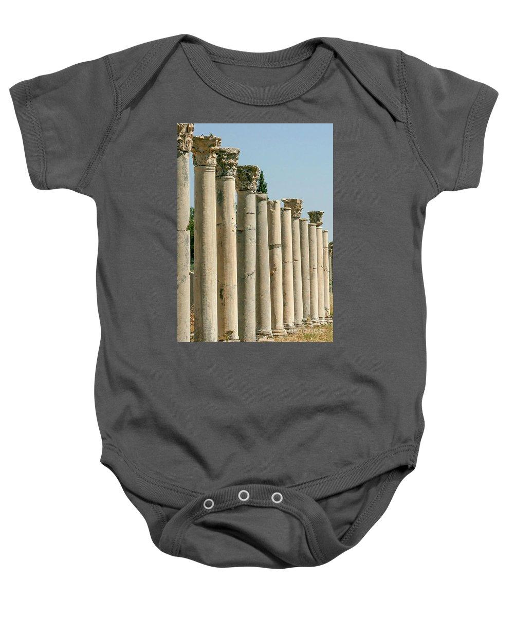 A Row Baby Onesie featuring the photograph Corinthian Columns In Turkey by Sabrina L Ryan