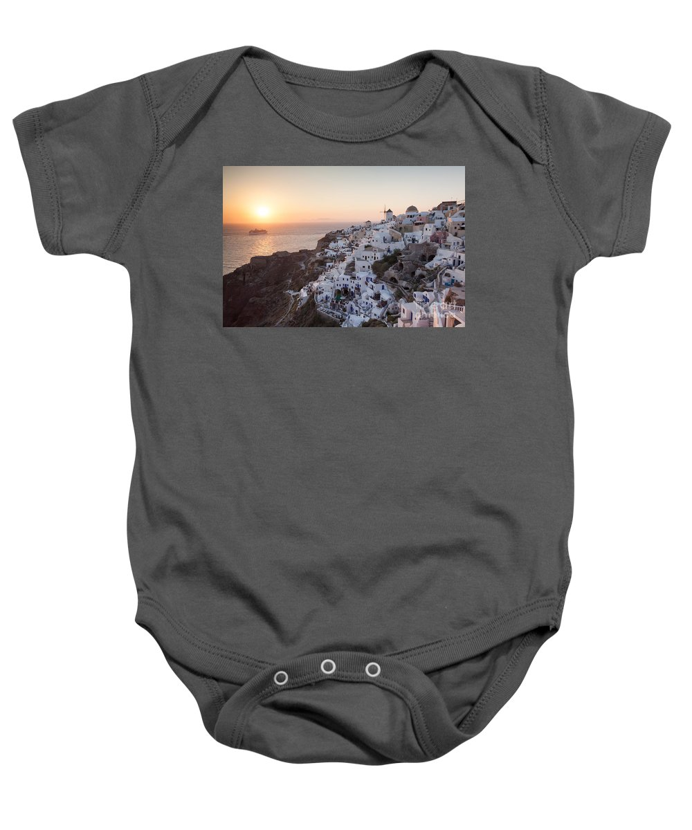 Europe Baby Onesie featuring the photograph Cruise Ship At Sunset In The Mediterranean Sea Santorini Greece by Matteo Colombo