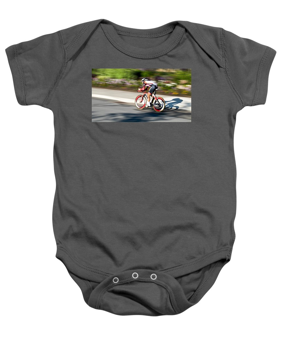 Cyclist Baby Onesie featuring the photograph Cyclist Racing The Clock by Kevin Desrosiers