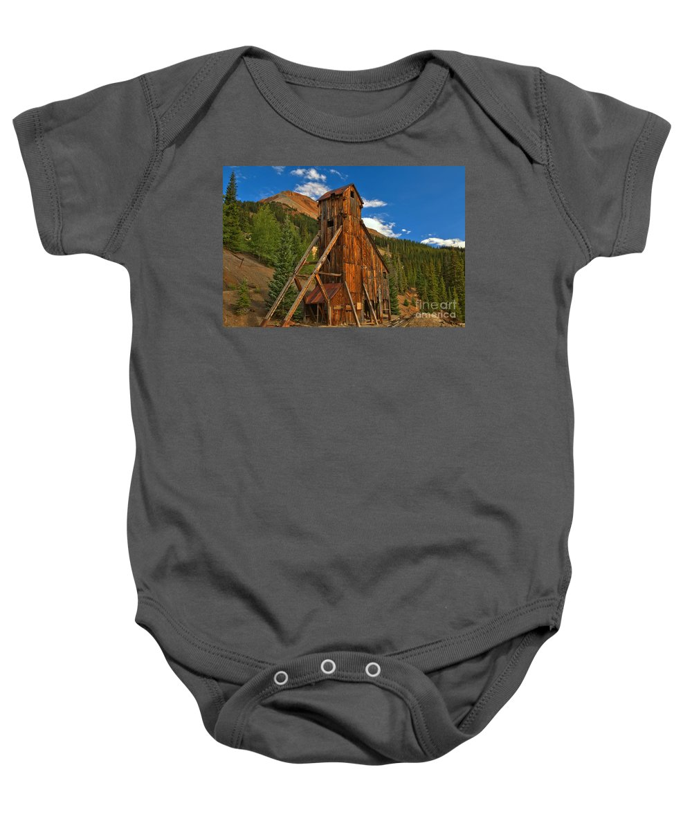Yankee Girl Mine Baby Onesie featuring the photograph Deep Blue Over Historic Silver And Gold by Adam Jewell