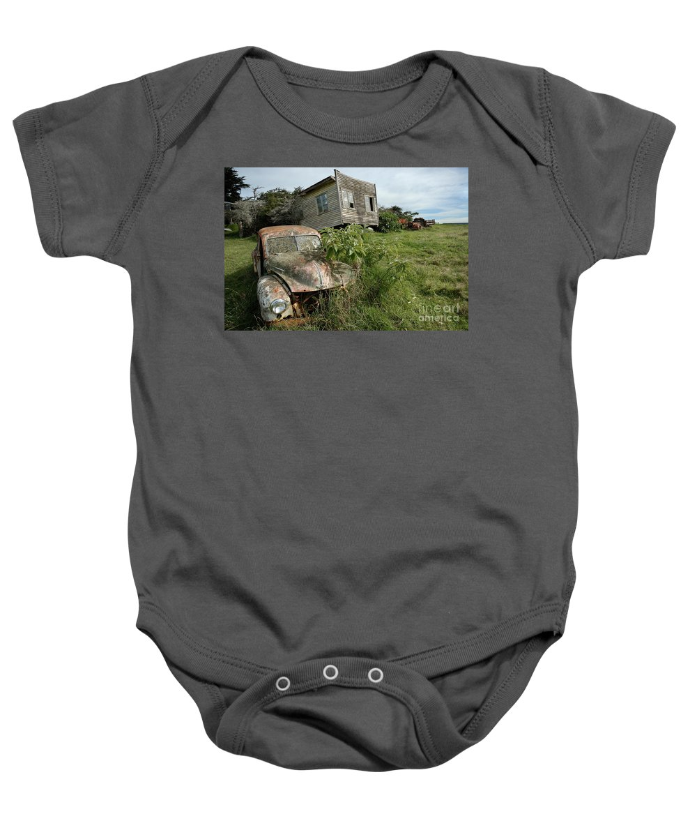 Classic Baby Onesie featuring the photograph Derelict Morris And Old Truck On An Abandoned Farm by Frank Kletschkus