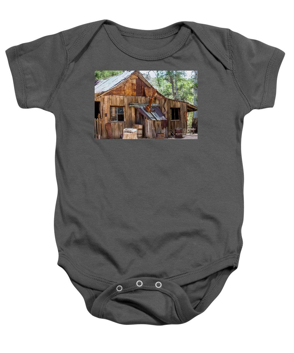 Baby Onesie featuring the digital art Desert Outback Farm Building by Georgianne Giese