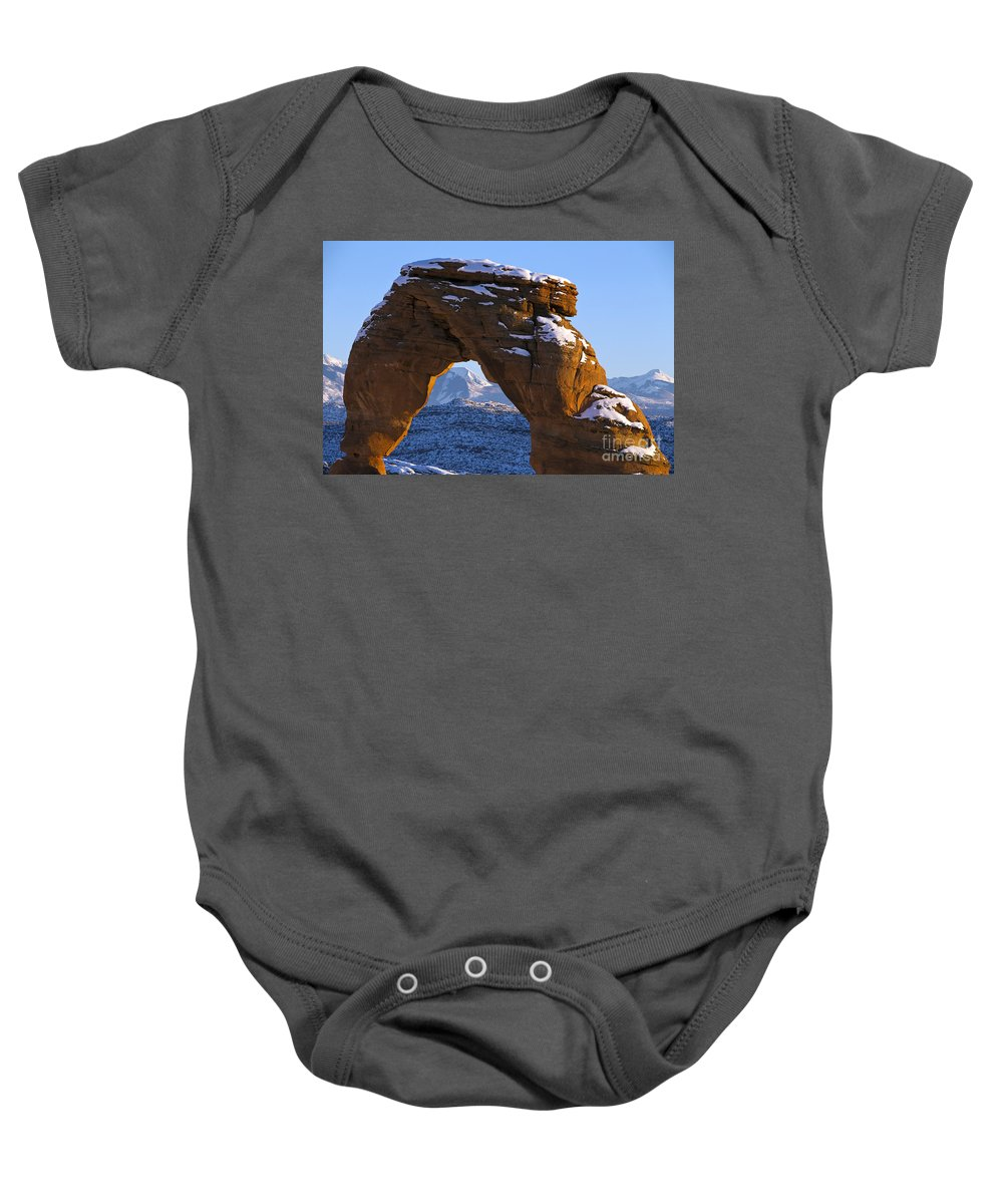 Arches Baby Onesie featuring the photograph Detail Of Delicate Arch With Snow Arches National Park Utah by Jason O Watson