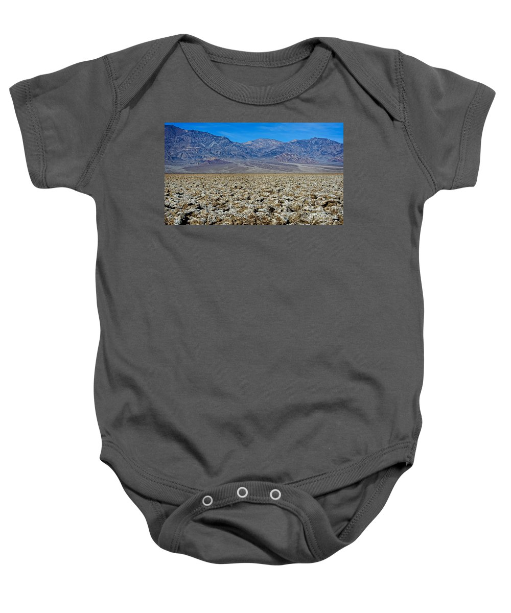 Art Baby Onesie featuring the photograph Devil's Golf Course by Charles Dobbs