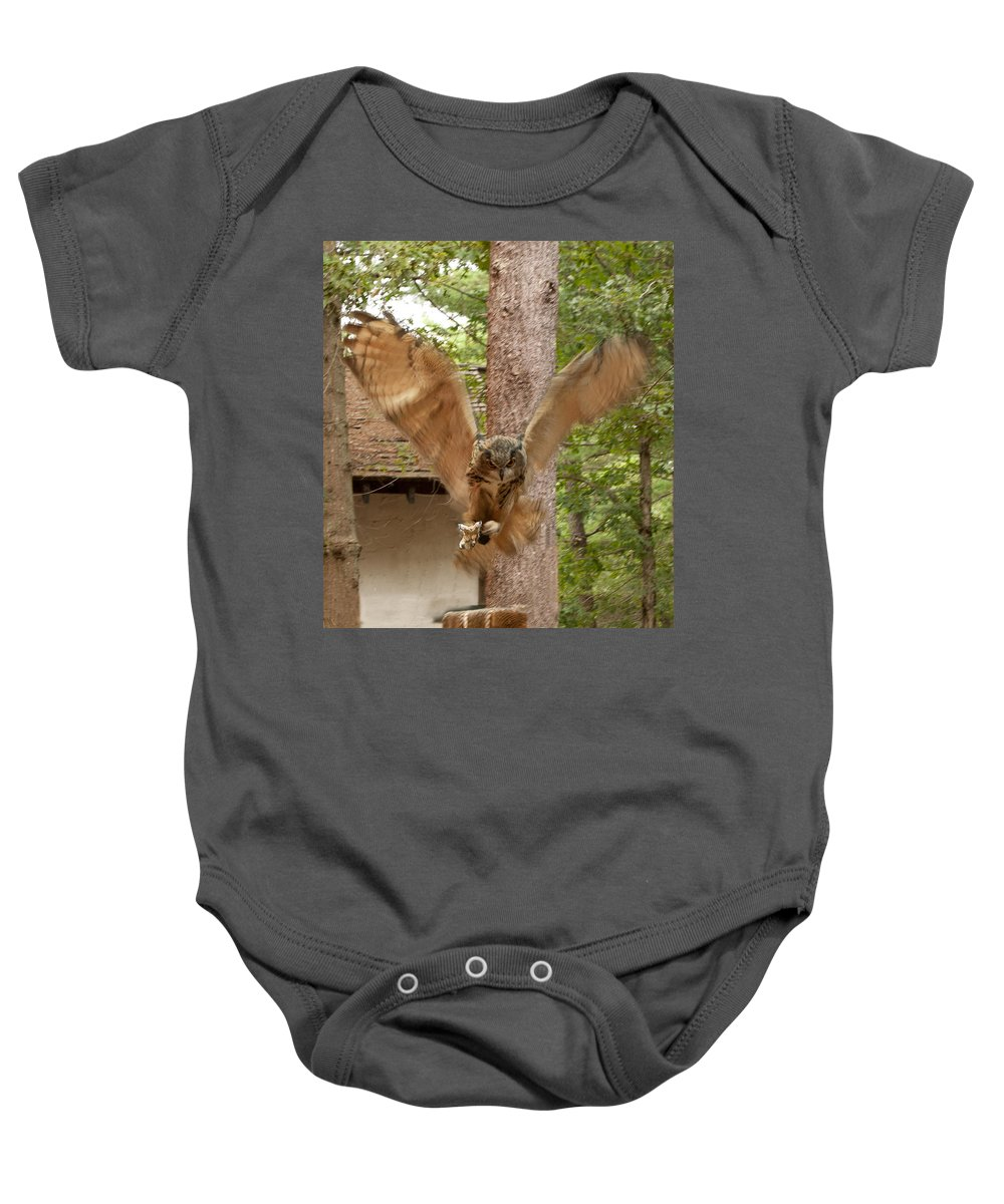 Bubo Bubo Baby Onesie featuring the photograph Eagle Owl Makes The Leap by Jeff Folger