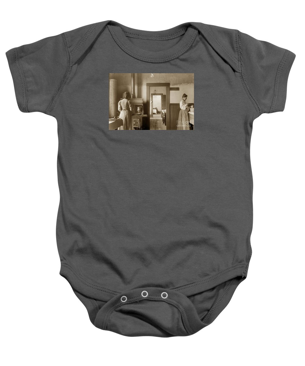 Wood Kitchen Baby Onesie featuring the photograph Early Kitchen With A Wood Kitchen Stove Circa 1906 by California Views Archives Mr Pat Hathaway Archives