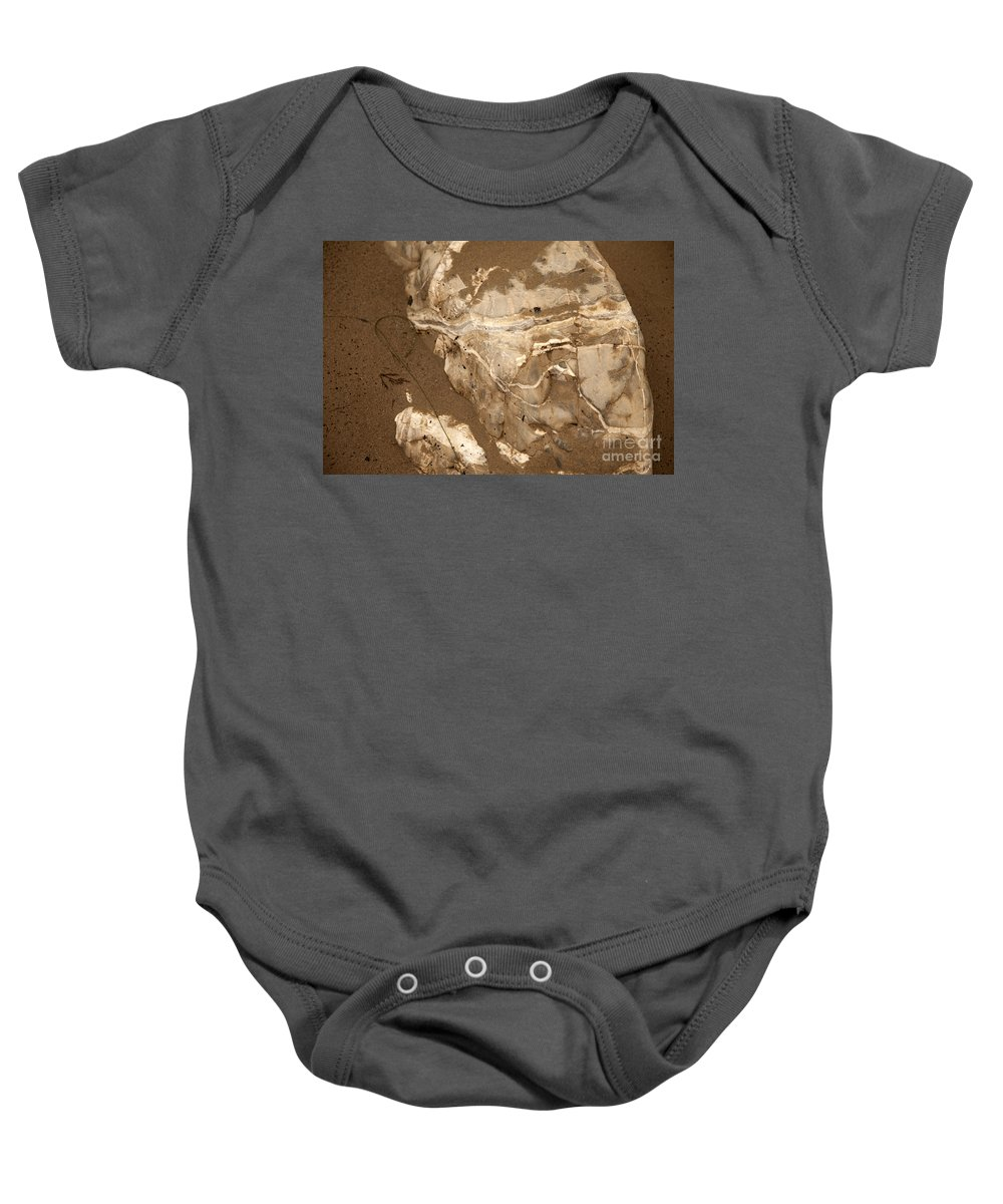 close Up Of Rocks In Sand Baby Onesie featuring the photograph Facing The Past by Amanda Barcon