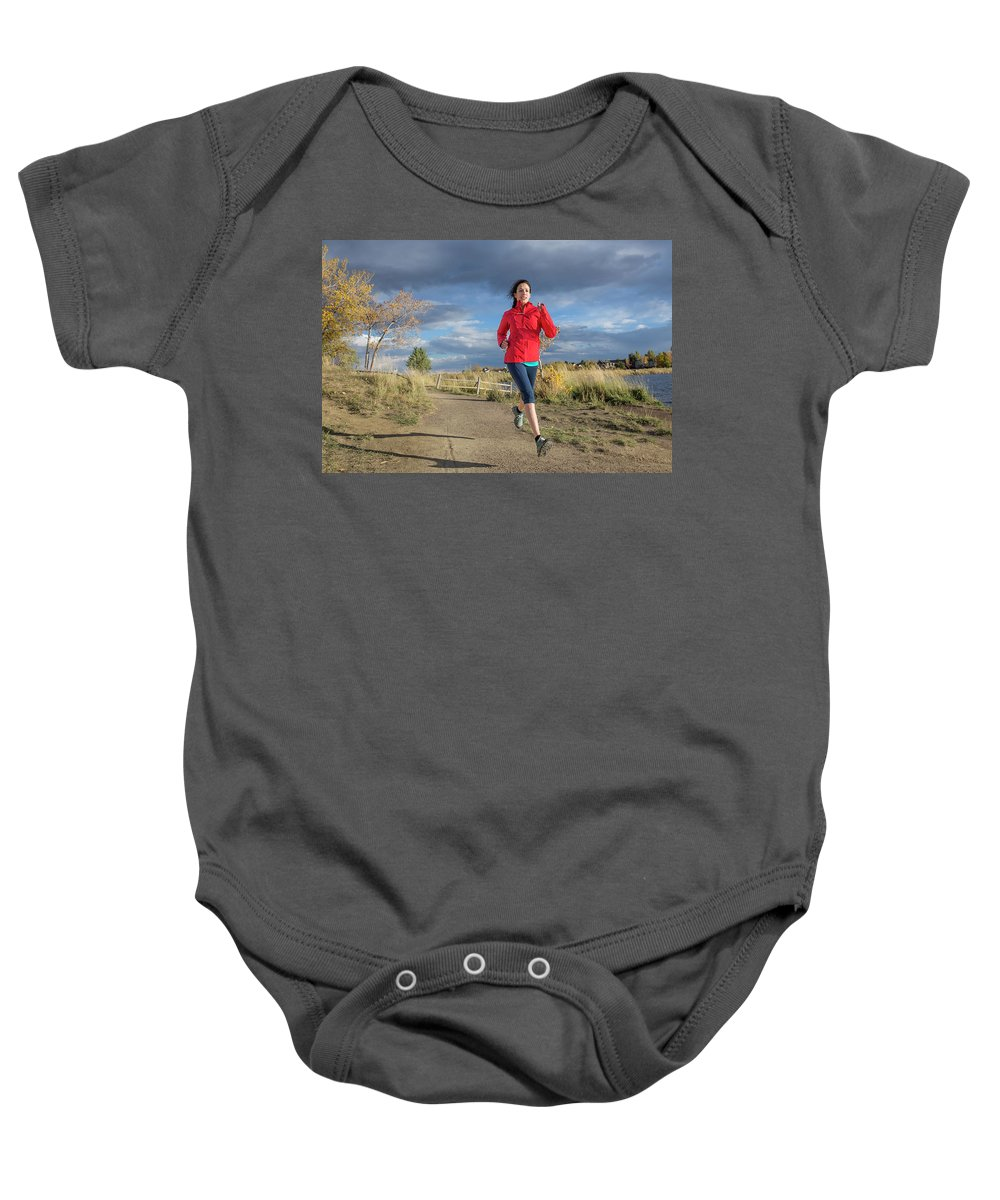 Healthy Lifestyle Baby Onesie featuring the photograph Female Runner In Colorado by Alexandra Simone