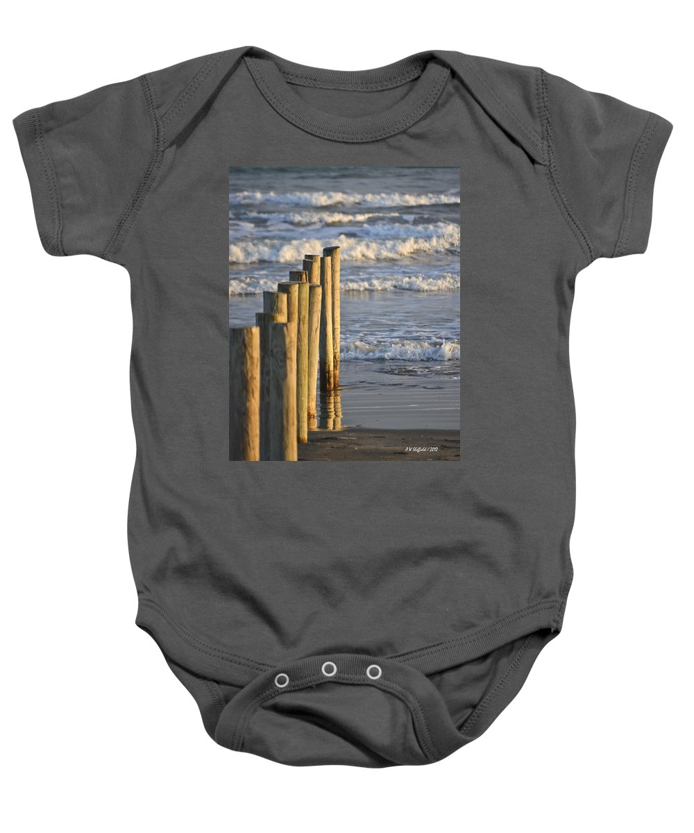 Galveston Baby Onesie featuring the photograph Fence Posts Into The Sea by Allen Sheffield