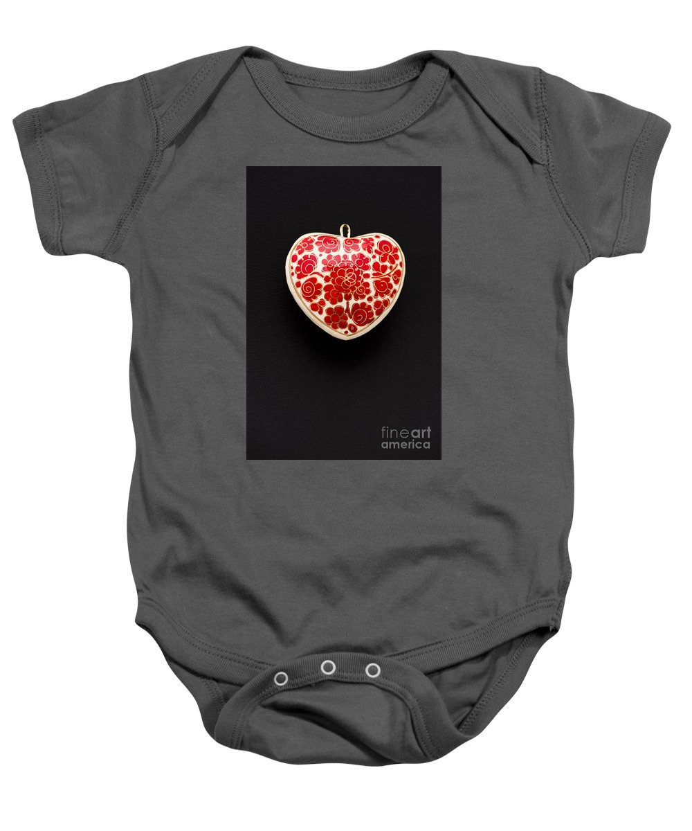 Background Baby Onesie featuring the photograph Festive Heart by Anne Gilbert