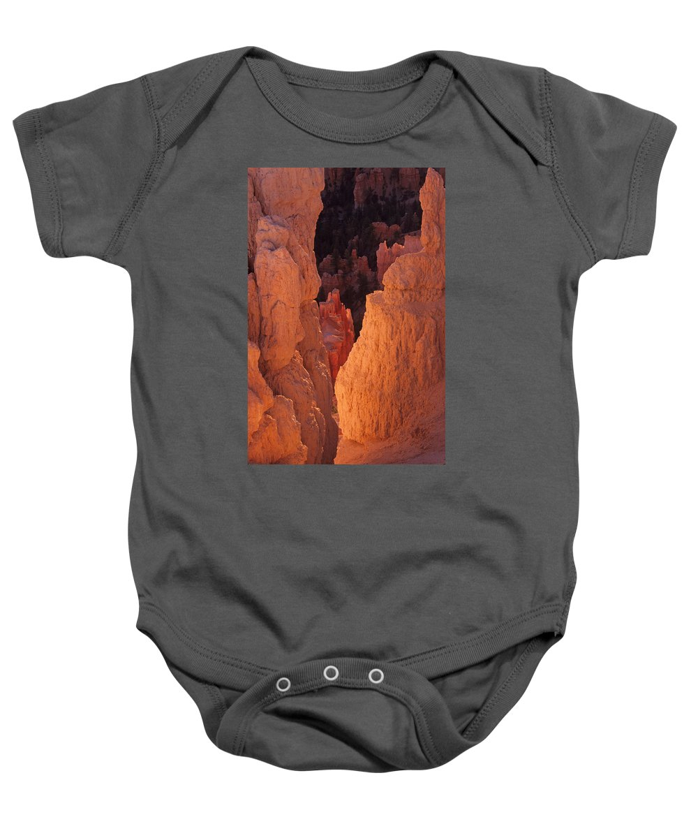 Utah Baby Onesie featuring the photograph First Light On Hoodoos by Susan Rovira
